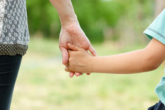 Mother holding her son's hand Royalty Free Stock Images