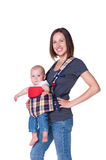 Mother holding her son in the sling Royalty Free Stock Photography