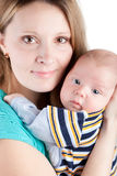 Mother holding her sweet little baby. Cute mother holding her sweet little baby Stock Photography