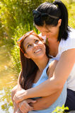 Mother holding her teen daughter in arms Stock Image