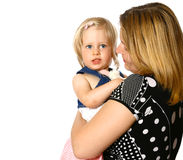 Mother holding her toddler girl Stock Images