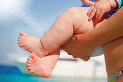 A mother holding his baby feet Royalty Free Stock Images