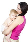 Mother holding a naked baby in her arms. Beautiful naked mother holding baby in her arms Royalty Free Stock Image