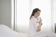 Mother Holding Newborn Baby On Bed Royalty Free Stock Photo