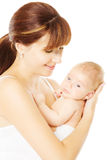 Mother holding newborn baby in hand, white backgro Royalty Free Stock Images