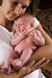 Mother holding newborn baby in her arms Stock Photo