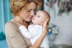Mother holding a newborn baby in her arms Stock Photography