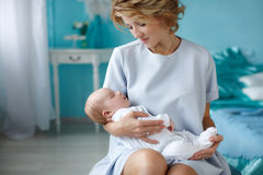 Mother holding a newborn baby in her arms Stock Photo