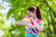 Mother holding newborn baby in a park Royalty Free Stock Image