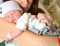 Mother holding newborn infant in hospital Royalty Free Stock Photos