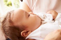 Mother Holding Sleeping Baby Boy At Home Stock Photography