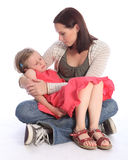 Mother holding sleeping daughter with love Royalty Free Stock Photos