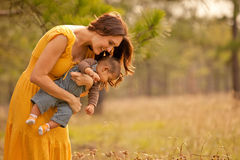 Mother Holding Son Exploring Nature Stock Image