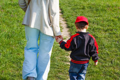Mother holding son hand Stock Image