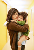 Mother holding son in hospital Royalty Free Stock Photo