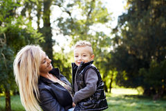 Mother holding son and laughing together Royalty Free Stock Photography