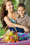 Mother holding son  outdoors smiling Royalty Free Stock Photo
