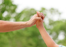Mother holding son's hand Royalty Free Stock Images