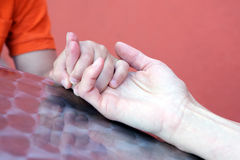 Mother holding Sons Hand Close Up. Close up of Mother Holding Sons Hand Royalty Free Stock Photos