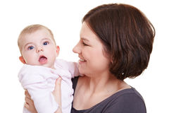 Mother holding surprised baby girl Royalty Free Stock Photos