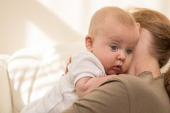 Mother holding sweet baby boy. Concept of happiness Royalty Free Stock Image