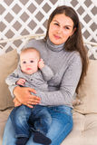 Mother holding sweet baby boy Royalty Free Stock Photos