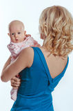 Mother holding sweet baby girl Stock Images