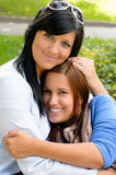 Mother holding teen daughter in her arms Stock Photography