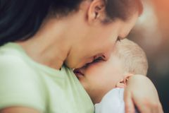 Mother holding to her asleep little son royalty free stock photos