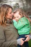 Mother holding toddler girl Royalty Free Stock Images
