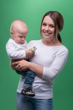 Mother holding toddler son with toy phone Stock Photos