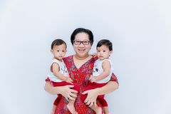 Mother holding two baby Boys. Great happiness, happy young mom with two twins baby. Portrait of young mother holding her little tw. Ins. Beautiful happy mother royalty free stock image