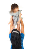 Mother holding up toddler girl Royalty Free Stock Image