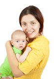 Mother holding  young baby Stock Photography