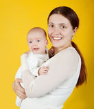 Mother holding  young baby Royalty Free Stock Images