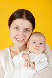 Mother holding  young baby Stock Photo