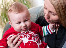 Mother holds baby boy son. A mother holding her baby boy son Stock Photography