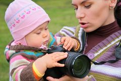 Mother holds baby with camera royalty free stock photography