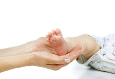 Mother holds baby leg Royalty Free Stock Photo