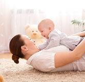 Mother holds child, indoors shoot Royalty Free Stock Photo