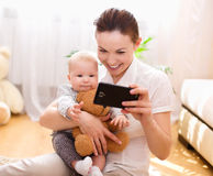 Mother holds child, indoors shoot Stock Photography
