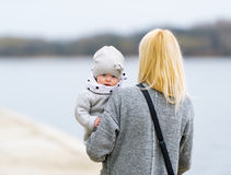 Mother holds the daughter on hands. Stock Photo