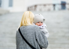 Mother holds the daughter on hands. Royalty Free Stock Photo