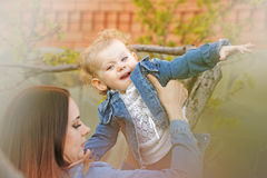Mother holds daughter on hands royalty free stock image