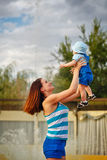 Mother holds daughter on hands. stock images