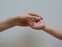 Mother holds hand of her baby Stock Photo