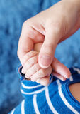Mother holds the hand of a newborn Stock Photography