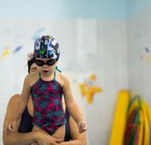 Mother teaches diving a child stock photography
