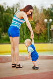 Mother holds her daughter's hand. royalty free stock images