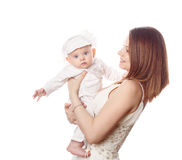 Mother holds her firstborn in her arms. Isolated. royalty free stock image